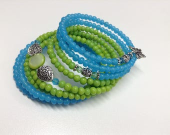 "Bracelet multi strand green and blue 8 rows mounted on stainless steel memory wire. Handmade ""one size"" size"