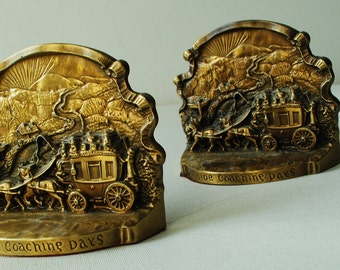 """Americana vintage 50s, bronze color brass bookends""""  Ye olde coaching days"""". Philadelphia heritage collection."""