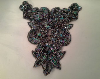 applique lace with pearls and dark blue glitter.