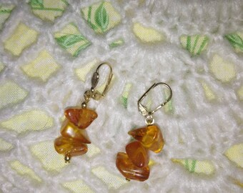Earrings in yellow gold 18 k and amber