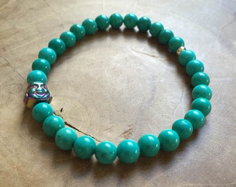 Turquois Buddha: an elastic beaded bracelet with a buddha head, rainbow hematite, and turquois