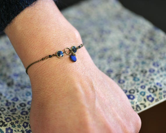 Fine brass bracelet with handmade vegetal patterns and blue beads 'Nelumbo'
