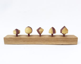 This Set of 5 Wooden Spinning Tops with Stand
