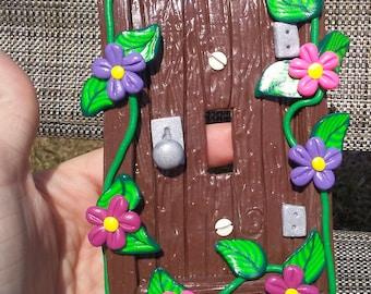 Fairy door light switch plate, flowers, door, fairies