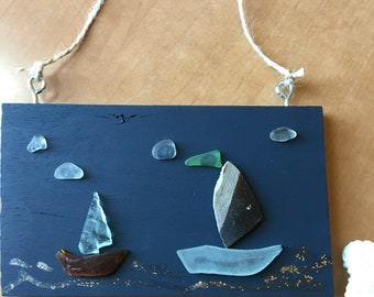 Small painted wood wall hanging with Seaglass boats and clouds