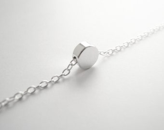 Silver bracelet with tiny dot bead pendant