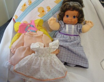 Magic Nursery doll with three outfits