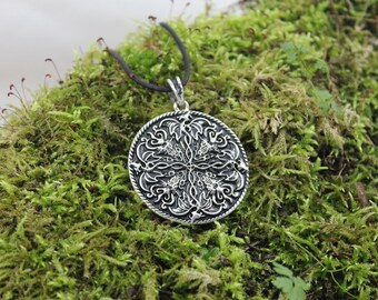 The four dragons, silver finish Locket