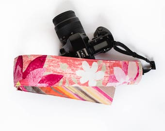 DSLR camera strap cover with lens cap pocket.  fiesta floral with stripes.