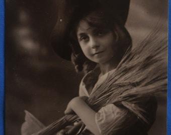 RPPC Girl Dark Hat The Harvester Wheat Sheaves Antique Divided Back Postcard