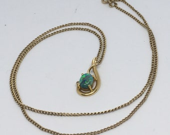 Vintage australian boulder opal and diamond pendant 18ct gold mount and 9ct chain