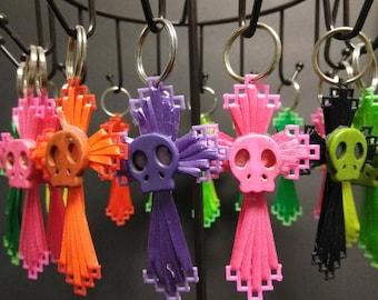 Handmade cross and skull keychains