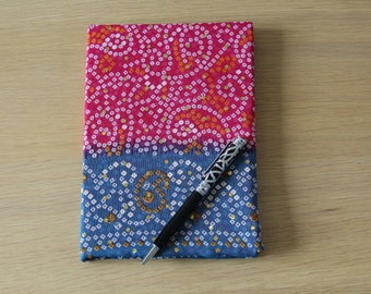 Notebook covered in pink and blue sari fabric
