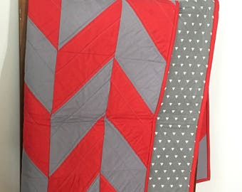 Red and grey herringbone quilt