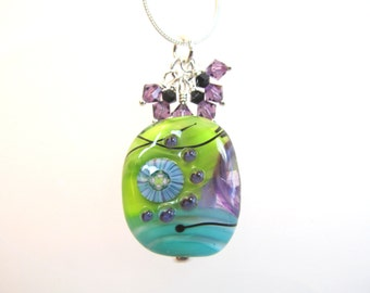 Necklace green, blue, purple, black glass art lampwork bead with purple & black crystals