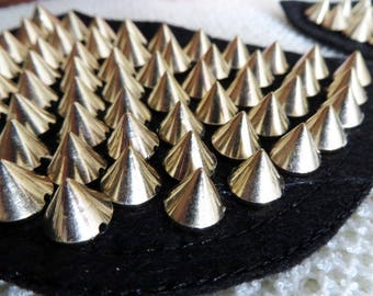 1 Pair of shoulder patch trims, black with gold spikes