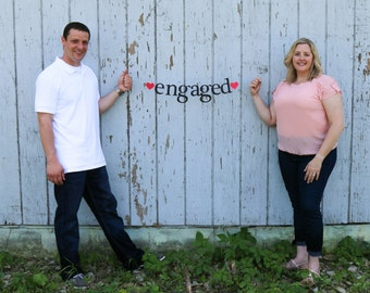 engaged.  we're engaged.  we eloped.  Ships Priority.  Surprise Announcement.  Banner. Valentine's Day.  Holiday Announcement.  5280 Bliss.