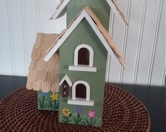 Green and White Birdhouse