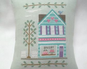 Bakery Building Cross Stitch Mini Pillow, Main Street Bakery, Completed Cross Stitch