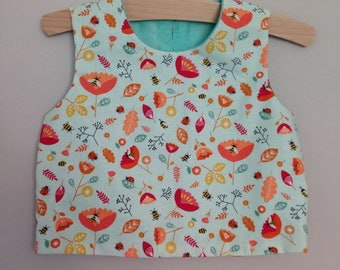 Handmade girls cotton top - age 3. Pale turquoise, with magenta pink and orange floral bees print.