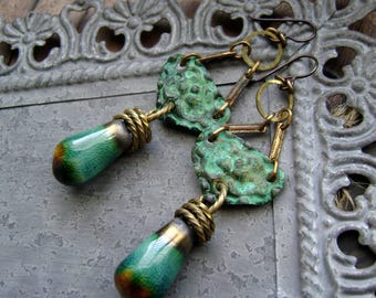 rustic artisan earrings with textured metal shields and artisan ceramics, verdigris patina, ooak, artifact style, bohemian, AnvilArtifacts