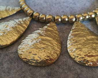 Beautiful t-shirt yarn and golden bead necklace