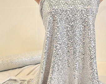 """Sewn on Sequin fabric 58"""" White   .. stretch all 4 ways..great for costumes, dance, theater, formal wear, pageant"""