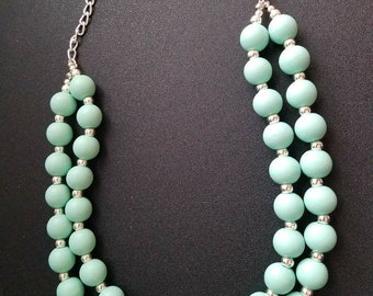 Light blue beaded double strand necklace