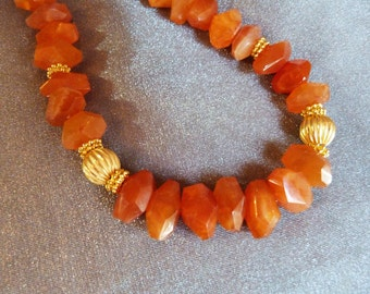 Vibrant carnelian necklace with gold plated accents