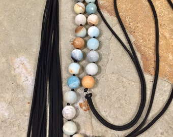 Boho style amazonite beaded necklace with a rich black leather tassel