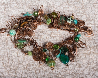 Rustic, chunky Copper charm bracelet with green and blue beads