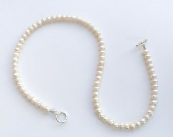 White freshwater pearl necklace with silver clasp