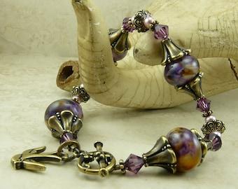 Amethystium Steampunk Victorian Inspired > Purple Amethyst Swallow Crystal - Lampwork Bead & Vintage Brass Bracelet I ship Internationally
