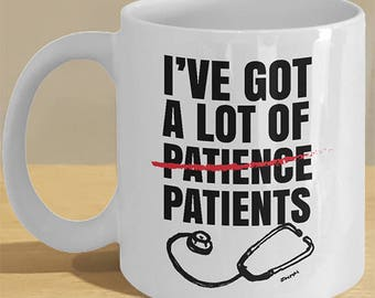 Funny doctor, graduate doctor mug gifts  // Dr. quote with Stethoscope illustration on coffee cup // 'I've Got A Lot of (Patience) Patients'