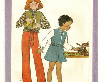 "A Long Sleeve, Ruffle Collar Blouse, Lined Vest, Flare Skirt, and Elastic Waist Pants Pattern: Child's Size 5, Breast 24"" • Simplicity 8671"