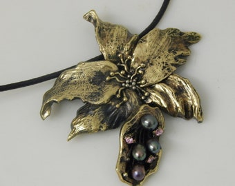 pendant on cord «Orchid»,jewelry made of brass with pearls and a cube of zirconium