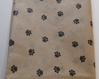 "10 Sheets of Black Paw Print on Kraft Tissue Paper (20"" x 30"")"