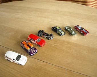 Lot of 7 Die Cast Cars – 3 are Hotwheels, 1 is a Mcdonald's Happy Meal Toy, and 3 are Unknown