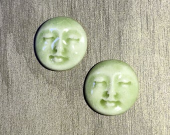 Pair of Two Medium Round Ceramic Face Stone Cabochons in Celedon