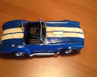 Tin sports car. AC Cobra
