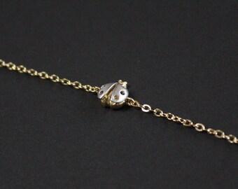 Tiny ladybug bracelet in gold