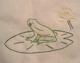 Tree frog on lily pad tea towel- hand embroidered