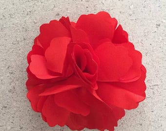 Barrette clip has red flower