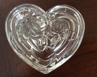 A Small Heart Shape Clear Glass Trinket Box with Raised Flowers.