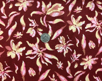 Floral on maroon cotton interlock knit 1 YD
