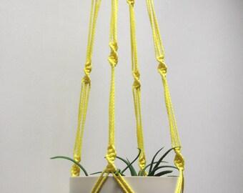 Yellow hanging planter. Macrame plant hanger. Hanging flowerpot holder.