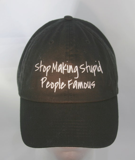 Stop Making Stupid People Famous (Polo Style Ball Black with White Stitching)