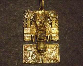 Aztec gold wash pendant, ornate face with headdress,  36 x 25 mm .  (G54)