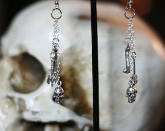 Skull, bones and axes earrings