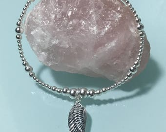 Beautiful sterling silver ball bracelet with Large antique style sterling silver angel wing charm stackable